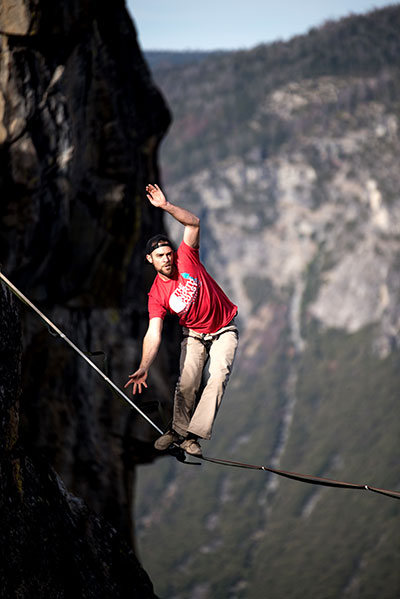 tightrope between cliffs